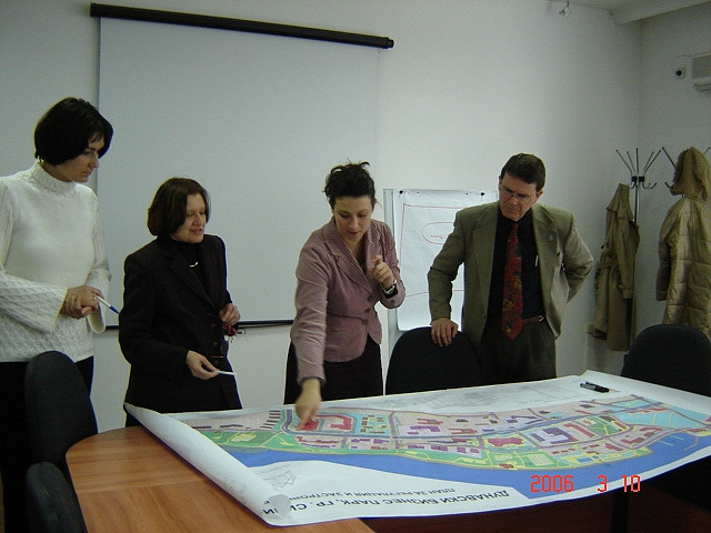 Employees overlooking a map of a town