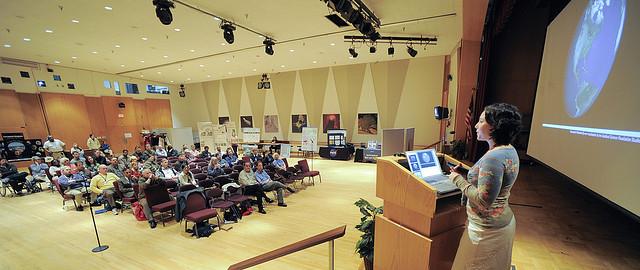 A woman giving a presentation at the NASA Goddard Space Flight Center
